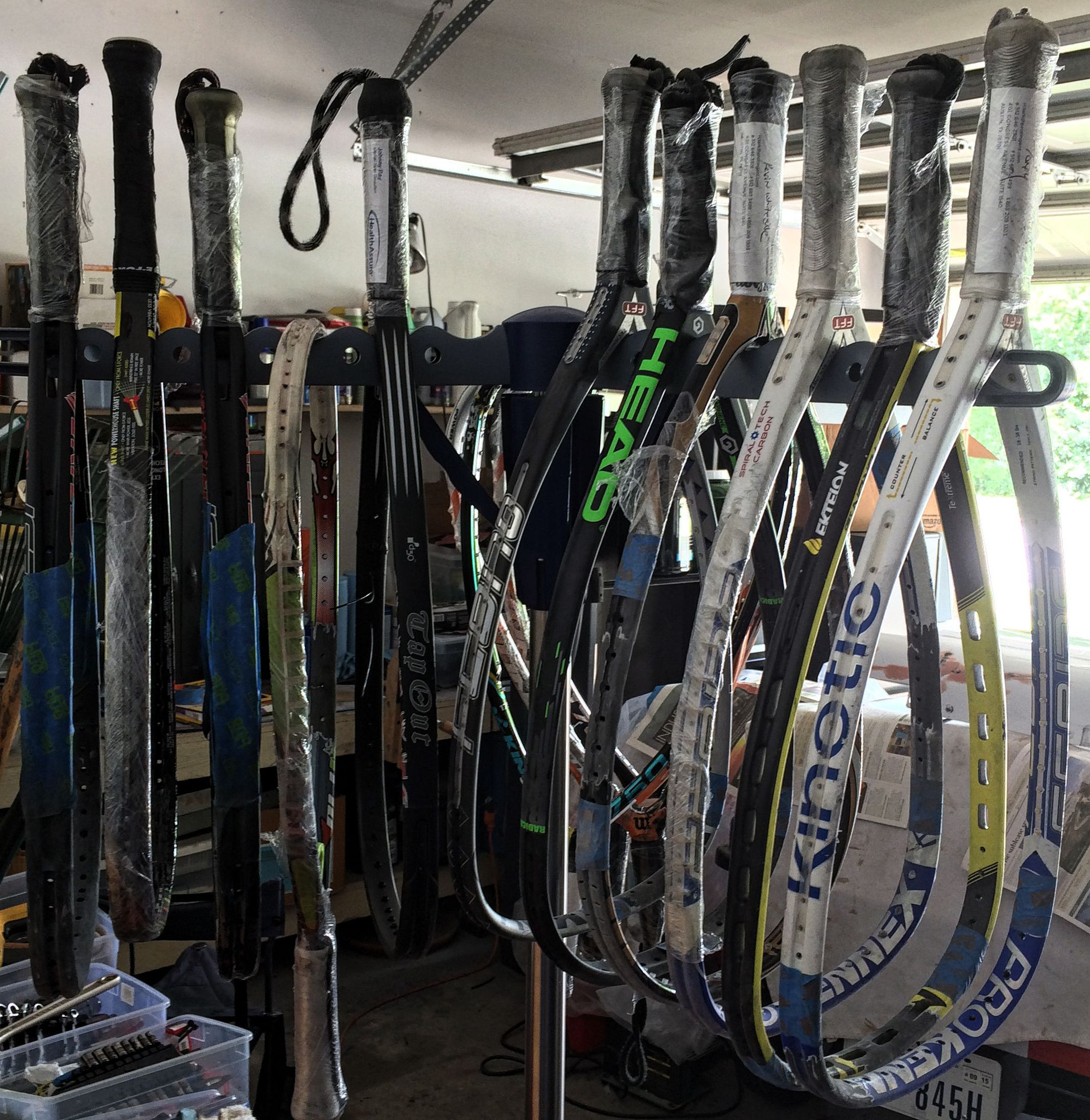 Bunch of racquets hanging 1